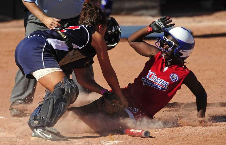 Levittown catcher Kristen Arbiter tags out Wilson County's
