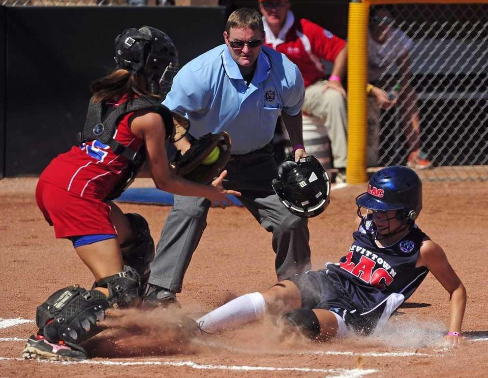 Levittown's Meghan Acton slides in safely under the