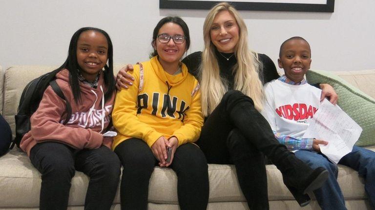 WWE wrestler Charlotte Flair meets Long Island kids