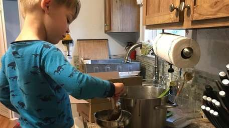 Austin Lawther, 5, helping mother, Virginia make chocolate