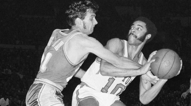 The Lakers' John Egan attempts to wrestle the