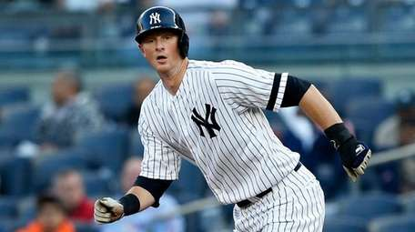 DJ LeMahieuof the Yankees breaks from first base