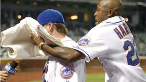 New York Mets' Willie Harris, right, hits teammate