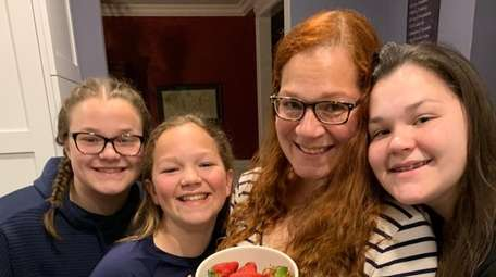 Nesconset's Rebecca McDonald, second right, with daughters Erin,