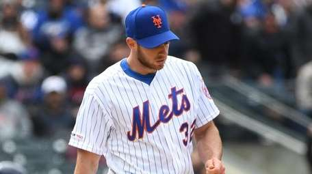 Mets starting pitcher Steven Matz stands on the