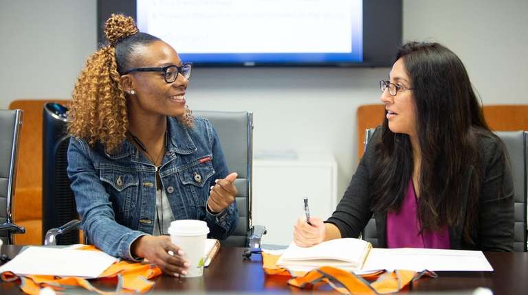 New employees Tiara Mitchell of Westbury, left, and