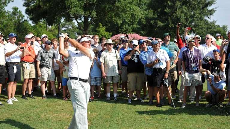 Phil Mickelson hits shot during a practice round