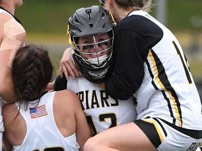 St. Anthony's players mob goalie Erin O'Grady after