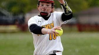 Commack's starting pitcher Sarah O'Connor (10) delivers a