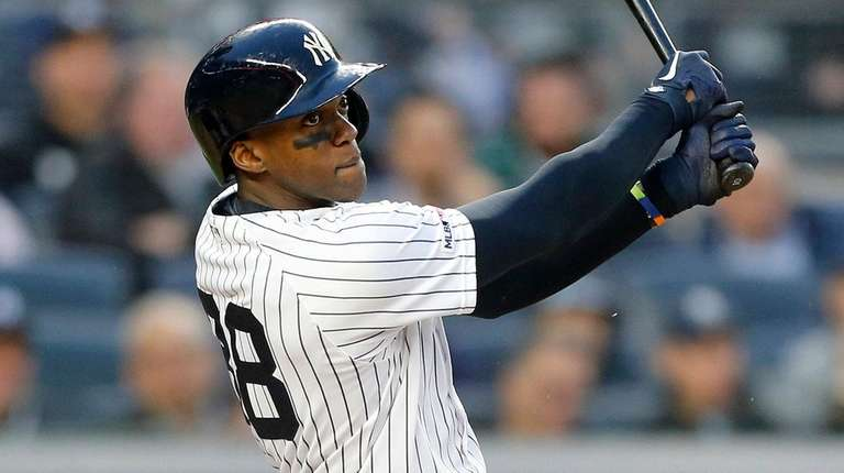 Cameron Maybin of the Yankees follows through on