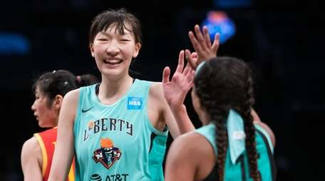 Liberty center Han Xu celebrates with guard Brittany