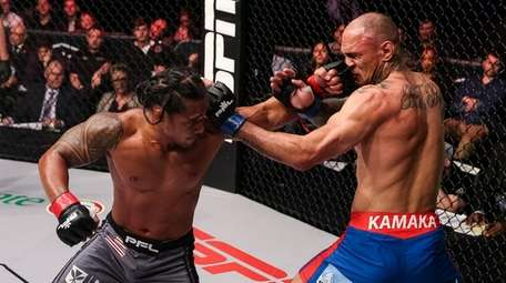 Ray Cooper III, left, fights Zane Kamaka during
