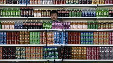 Chinese artist Liu Bolin waits for his colleagues