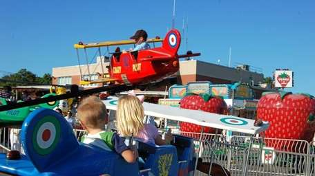 Kids on airplane carnival rides during last year's