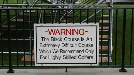 The sign displayed at the first tee at