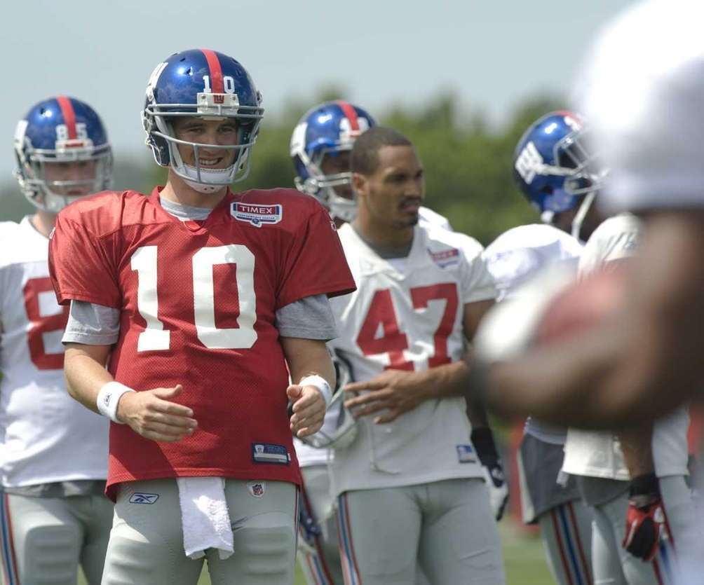 Eli Manning reacts to a route run by