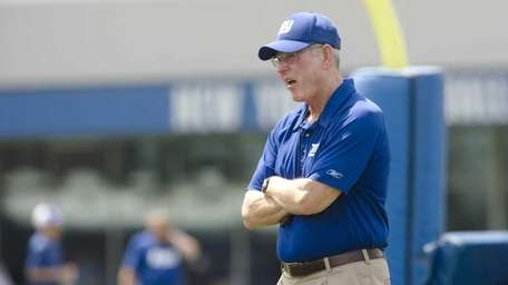 Tom Coughlin watches his team practice at the