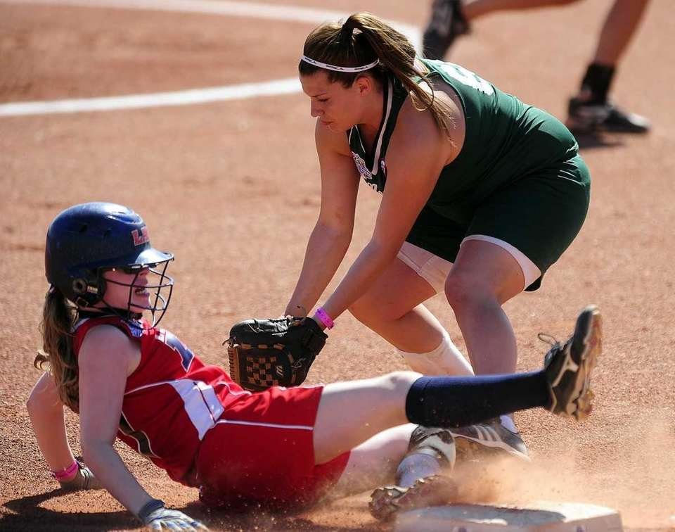 Levittown's Kaitlin Mars slides safely under the tag