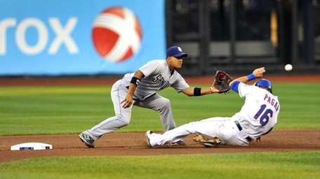 Angel Pagan safely steals second base in the