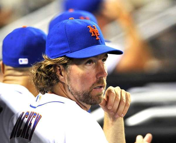R.A. Dickey looks on during the ninth inning