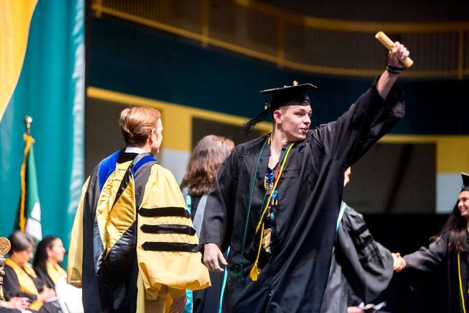 A graduate celebrates during LIU Post's commencement Friday.