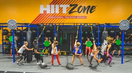 Women work out at a Crunch Fitness franchise.