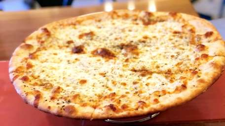A cheese and herb pizza at Pinon's Pizza