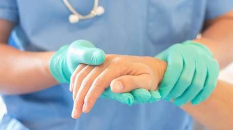 Surgeon, surgical doctor, anesthetist or anesthesiologist holding patient's