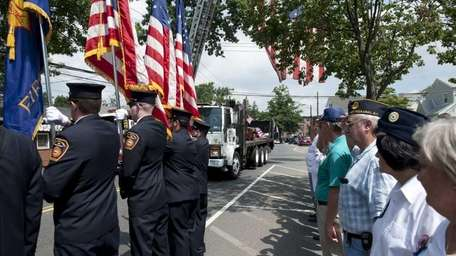 Firefighters from the East Rockaway Fire Department and