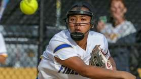 Daisha Howard #25 of Kellenberg scoops up an