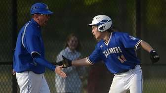 Dan Cardito #11, Kellenberg centerfielder, gets congratulated after