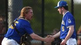 Joe Braskey #15, Kellenberg catcher, left, and pitcher