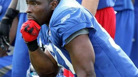 Justin Tuck takes a break at the Giants