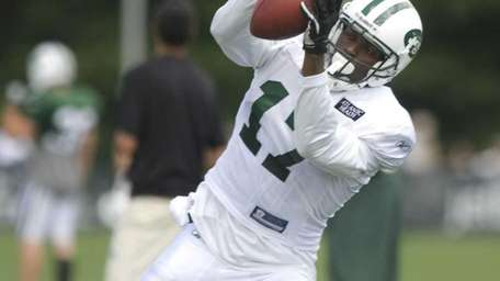 Jets wide receiver Plaxico Burress catches a pass