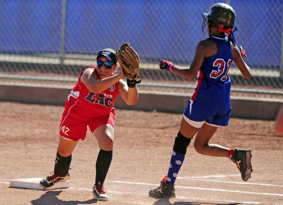 Levittown first baseman Alexa Serrano puts out Wilson