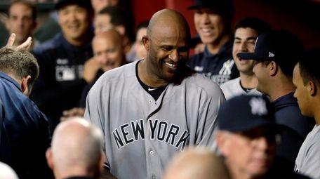 Yankees starting pitcher CC Sabathia walks through the