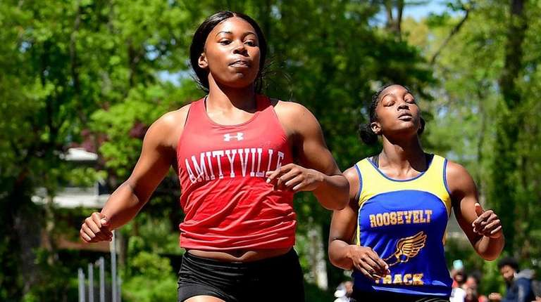 Indya Hunter of Amityville wins the girls 100-meter
