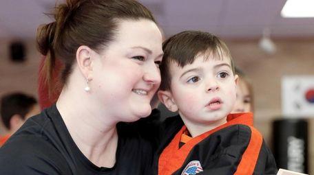 Melinda Constantine celebrates with her son Lucas Constantine,
