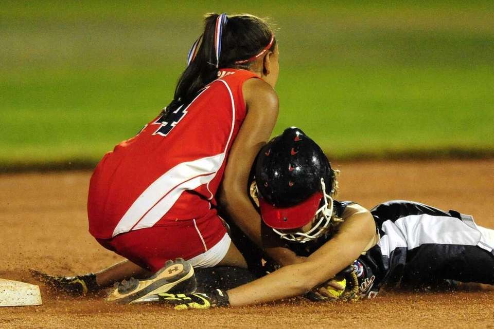 Levittown shortstop Shamar Sanchez tags out Wausau (Wisconsin)