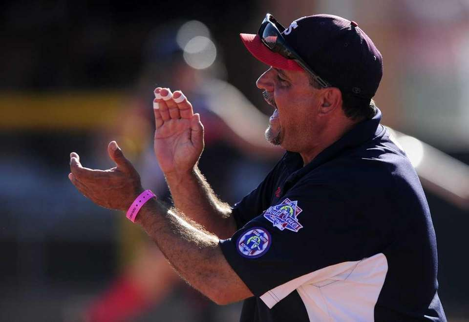 Levittown Slammers manager Mike Gordek cheers his players