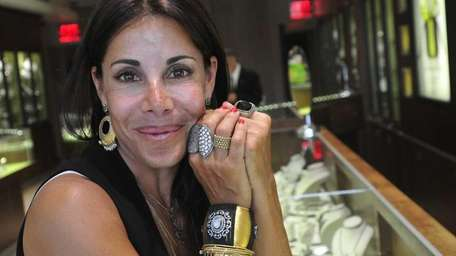 Idayne Kaye poses in her family's jewelry store,
