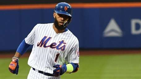 Mets shortstop Amed Rosario rounds third base on