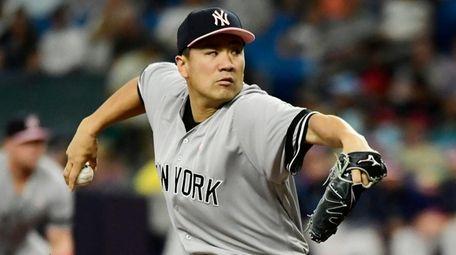 Masahiro Tanaka #19 of the Yankees delivers a