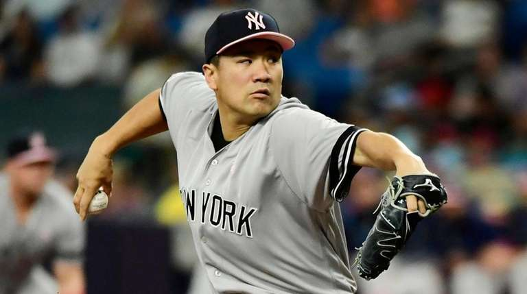 Masahiro Tanaka #19 of the Yankees delivers a