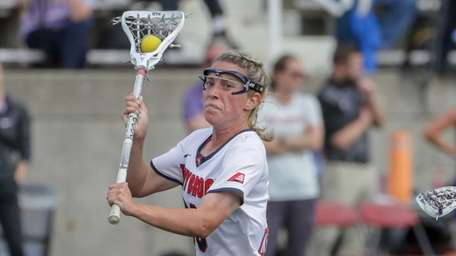 Ally Kennedy #30 of Stony Brook drives against
