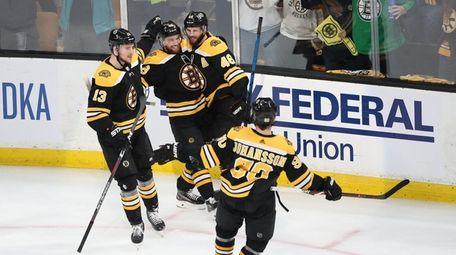 Matt Grzelcyk #48 of the Boston Bruins celebrates
