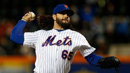 Robert Gsellman #65 of the Mets pitches during