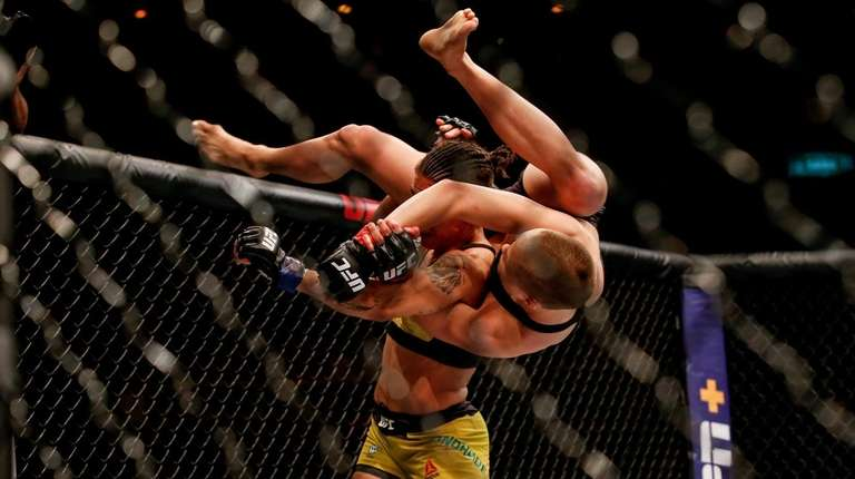 Jessica Andrade of Brazil attempts to slam Rose