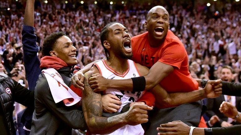 f27364a0ea9 Kawhi Leonard s last-second shot gives Raptors win over 76ers in Game 7  thriller