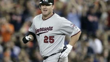 Minnesota's Jim Thome rounds the bases on his